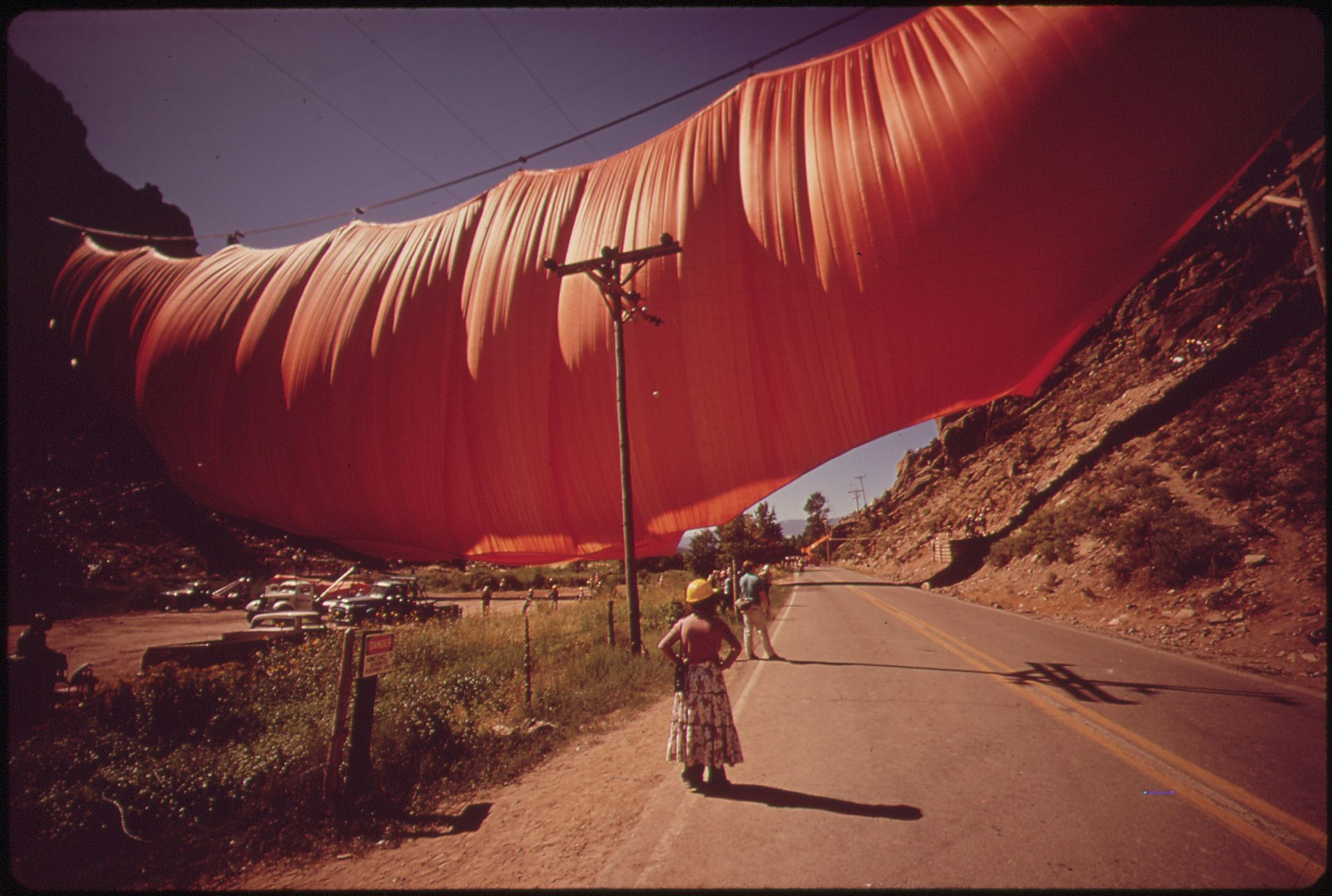 "Christo and Jeanne-Claude's ""Valley Curtain"" swells with wind in Rifle Gap State Park in 1972, just outside of Rifle, CO. The curtain hung for 28 hours before succumbing to a gale wind."