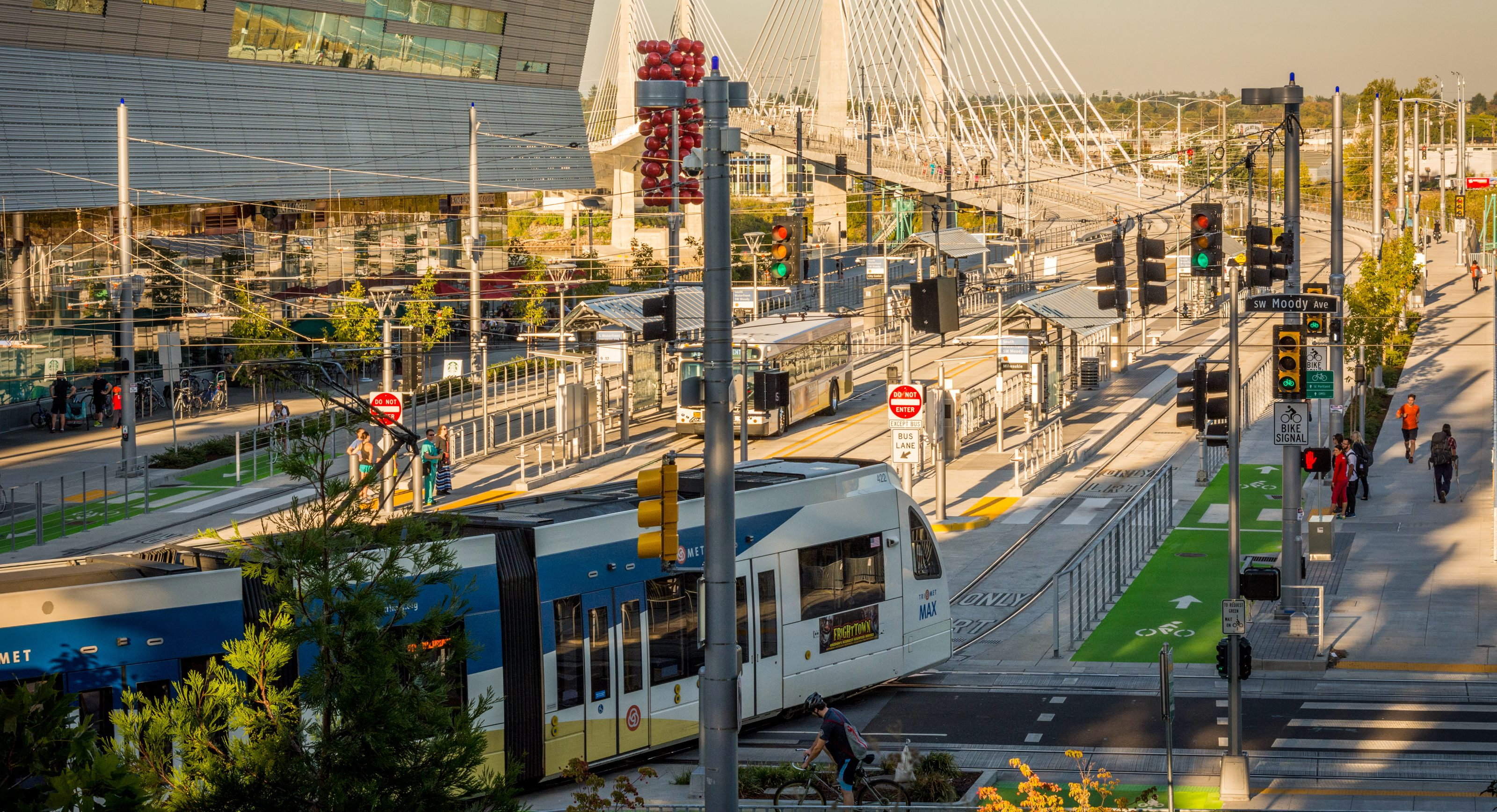 Pictured is the Tilikum Crossing Bridge in Portland, OR which serves buses and light rail and has bike baths and walkways for people.
