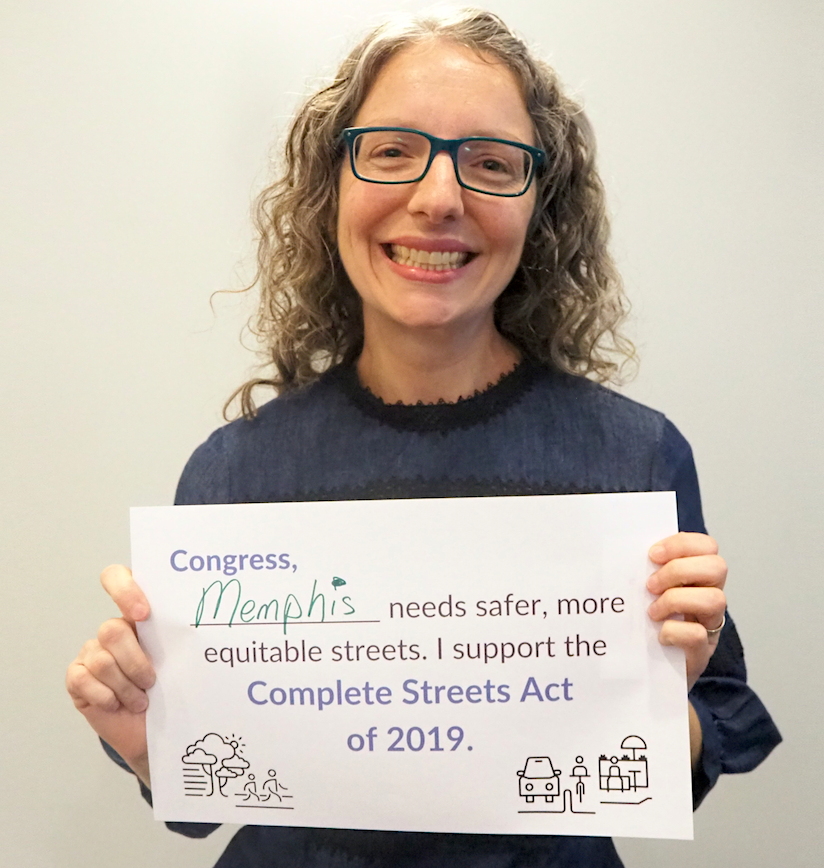 "Sylvia holding a poster that reads, ""Congress, Memphis needs safer more equitable streets. I support the Complete Streets Act of 2019."""