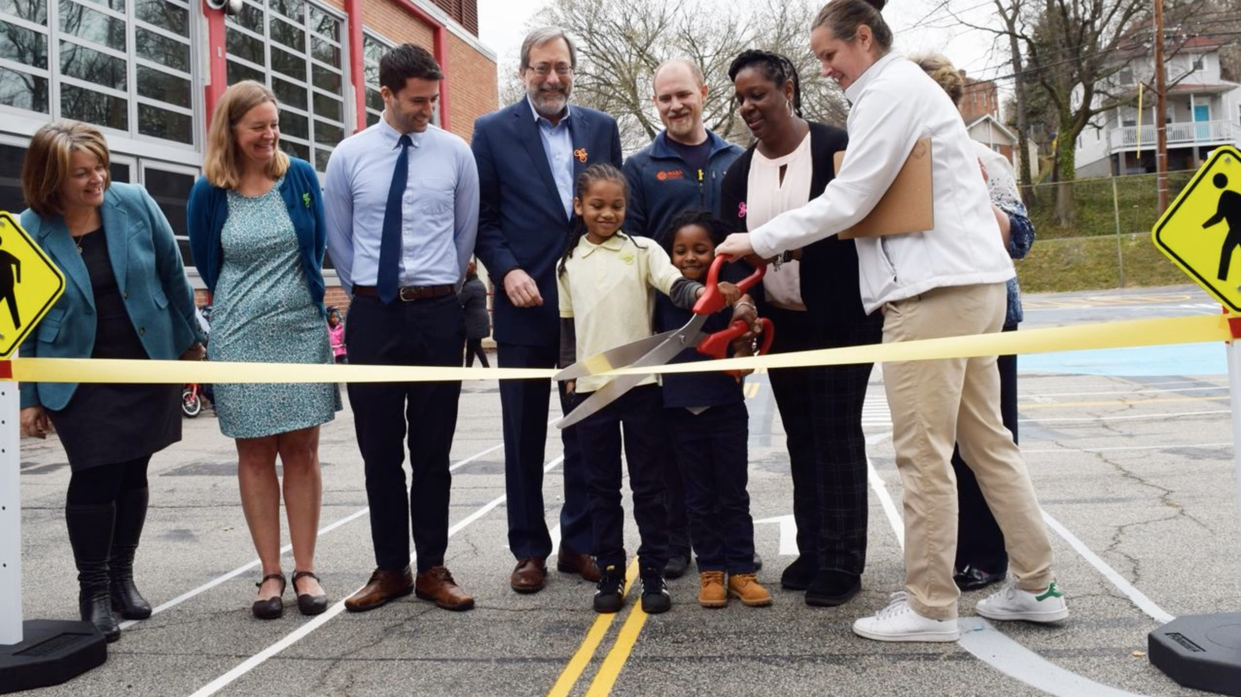 children cutting a ribbon on a new project