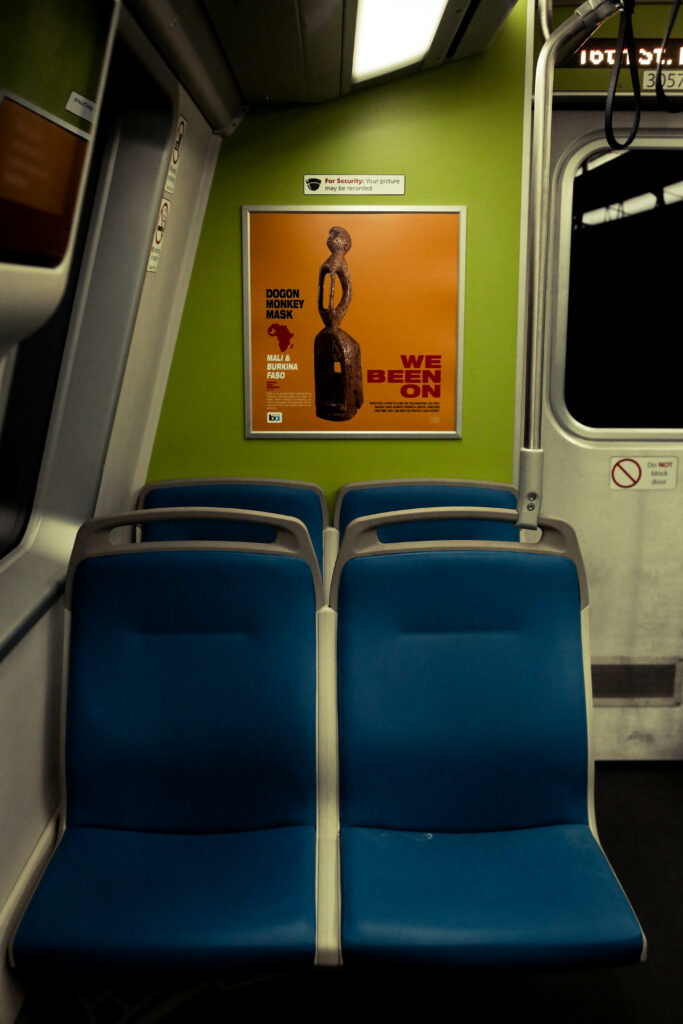 Image of bright orange poster on a green wall of a train.